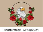 vector eagle in a circle of red ... | Shutterstock .eps vector #694309024