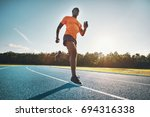 fit and focused young african... | Shutterstock . vector #694316338