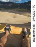 sandboarding at great sand dune ...   Shutterstock . vector #694331470