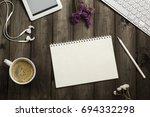 the desk of a modern man.... | Shutterstock . vector #694332298