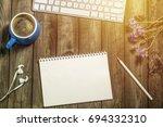 the desk of a modern man.... | Shutterstock . vector #694332310