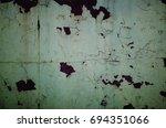 peeling plaster on the wall in...   Shutterstock . vector #694351066