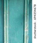 old grunge green wood texture...   Shutterstock . vector #694354678