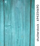 old grunge green wood texture...   Shutterstock . vector #694354690
