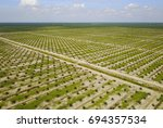 aerial view of palm plantation...   Shutterstock . vector #694357534