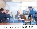 relaxed cheerful business... | Shutterstock . vector #694371793