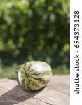 Small photo of Cucurbitaceae. zucchini on wooden table