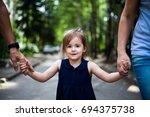 Child Holding Grandparents...