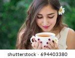 a beautiful young smiling woman ... | Shutterstock . vector #694403380