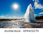 back lit of stokkur geyser with ... | Shutterstock . vector #694423270
