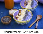 smoothie bowls with blueberries ... | Shutterstock . vector #694425988