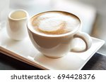 hot cappuccino coffee. | Shutterstock . vector #694428376