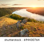 river canyon on sunset. | Shutterstock . vector #694430764