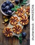 plum tarts with cinnamon  on a... | Shutterstock . vector #694435246