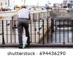 old man thinking near the...   Shutterstock . vector #694436290