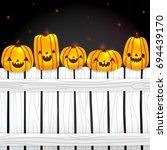 five little pumpkins sitting on ... | Shutterstock .eps vector #694439170