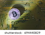 silver bitcoin on motherboard | Shutterstock . vector #694440829