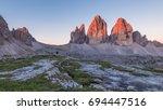 Summer sunrise at Tre Cime di Lavaredo in the Dolomites - stock photo