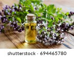 a bottle of oregano essential... | Shutterstock . vector #694465780