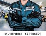 mechanic in the garage | Shutterstock . vector #694486804
