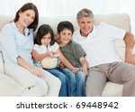 family watching tv while they... | Shutterstock . vector #69448942