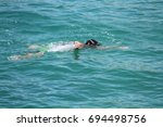 drowning in the sea | Shutterstock . vector #694498756