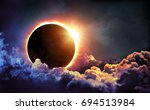 solar eclipse in clouds   moon... | Shutterstock . vector #694513984