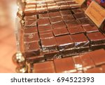 a lot of portions of chocolate | Shutterstock . vector #694522393