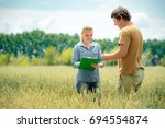 farmer and agronomist... | Shutterstock . vector #694554874