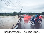 floods have flooded a street... | Shutterstock . vector #694556023