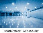 empty airport lounge...   Shutterstock . vector #694556809