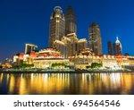 illuminated city waterfront... | Shutterstock . vector #694564546
