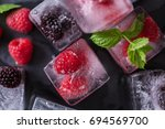 fruit ice cubes with organic... | Shutterstock . vector #694569700