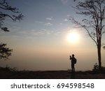 a backpacker man is taking... | Shutterstock . vector #694598548