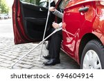 disabled person with crutches... | Shutterstock . vector #694604914