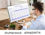 close up of a young businessman ... | Shutterstock . vector #694604974