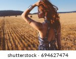 beautiful model wearing summer... | Shutterstock . vector #694627474