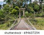 the wood suspension bridge over ... | Shutterstock . vector #694637254