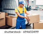 cargo delivery service  male... | Shutterstock . vector #694653499