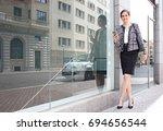 beautiful successful business... | Shutterstock . vector #694656544