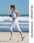 young woman jogging on the... | Shutterstock . vector #69465736