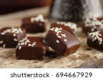 handmade chocolate candies with ...   Shutterstock . vector #694667929