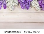 lilac flowers on the background ... | Shutterstock . vector #694674070
