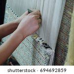 weaving and manufacturing of... | Shutterstock . vector #694692859