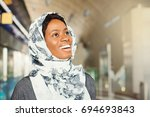 a smiling young african woman... | Shutterstock . vector #694693843