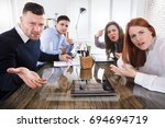 Small photo of Group Of Business Executives Complaining Toward Camera In Office