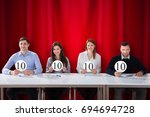 happy panel judges sitting in... | Shutterstock . vector #694694728