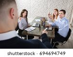 businessman asking question to... | Shutterstock . vector #694694749