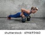 young muscular girl doing push... | Shutterstock . vector #694695460