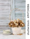 dried roses in white wicker... | Shutterstock . vector #694724086